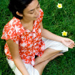Ethnic young woman meditate in nature — Stock Photo