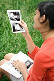 Happy pregnancy with ultrasound scan result — Stock Photo