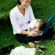 Working mom working and playing with child — Stock Photo