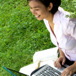 Stock Photo: Young woman enjoy working at outdoor
