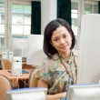Asian young woman in the computer classroom — Stock Photo