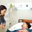 Granddaughter visit sick grandmother — Stock Photo #9155021