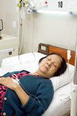Sick old woman patient sleeping during bed rest — Stock Photo
