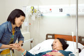 Granddaughter visit sick grandmother — Stock Photo