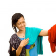 Ethnic asian girl choose an outfit — Stock Photo #9236340