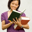 Asian college student open literature — Stock Photo