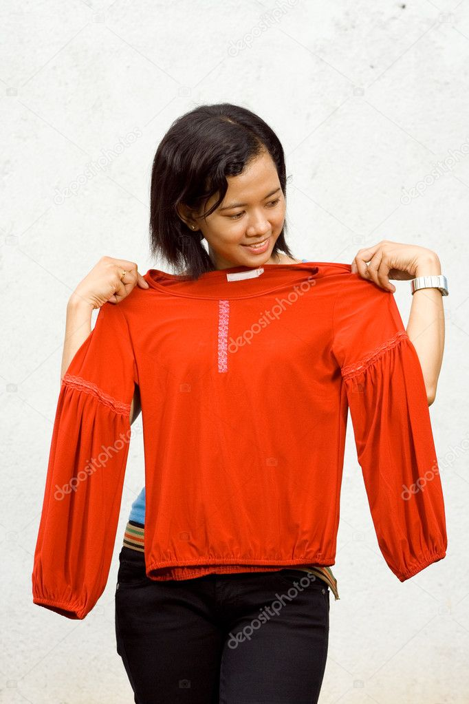Portrait of asian ethnic young woman happy fitting her clothes  Stock Photo #9236288