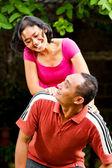 Cheerful attractive ethnic couple portrait — Stock Photo