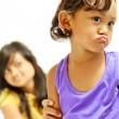 Stock Photo: Teen sister persuade cranky child