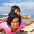 Asian mother and child fun play at the beach — Stock Photo