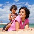 Cheerful asian family playing at the beach — Stock Photo #9726719