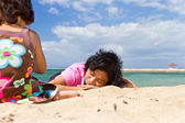 Asian family relaxing and playing at the beach — Stock Photo