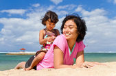 Cheerful asian family playing at the beach — Stock Photo