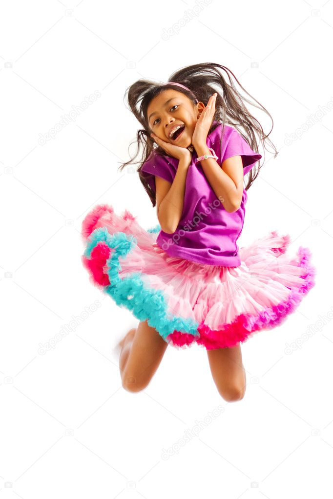 Cute asian ethnic girl with tutu skirt jump high isolated on white — Stock Photo #9726273