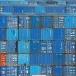 Stack of blue sea containers in an international port container shipping — Stock Photo #8378662
