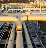 Pipe work of a natural gas plant — Stock Photo