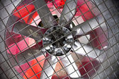 Industrial fan behind a metal grate — Stock Photo