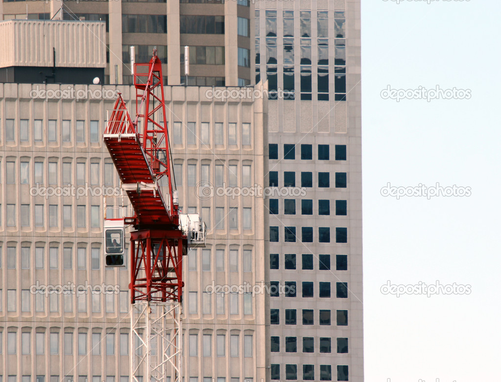 Construction site with a red crane  Stock Photo #9558769