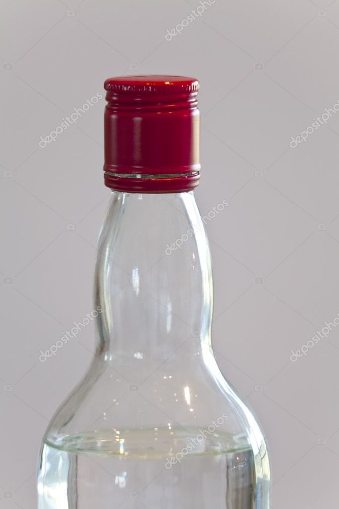 A bottle of vodka with a red top  Stock Photo #9647895