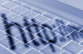 Schatten auf laptop-tastatur — Stockfoto
