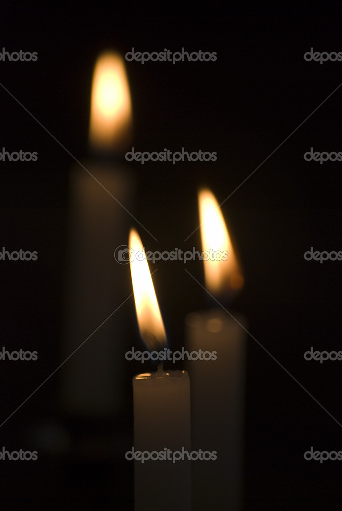 Closeup of flickering candles inside of church — Stockfoto #8459705