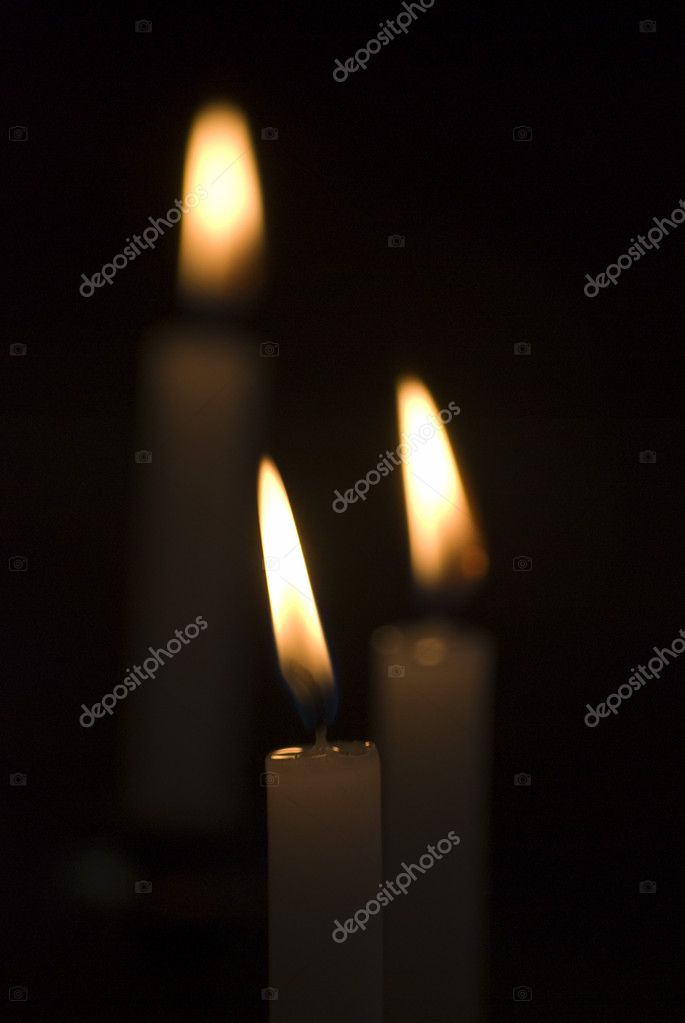 Closeup of flickering candles inside of church — Стоковая фотография #8459705