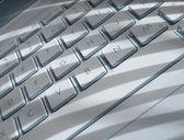 Shadows on laptop keyboard — Stock Photo