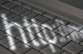 Shadows on laptop keyboard — Stock Photo