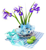 Easter reason with irises and easter eggs — Stock Photo