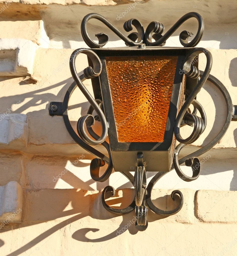 Beautiful forged yellow street lantern — Stock Photo #8759020