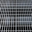 Grate on street — Stock Photo