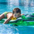 Stock Photo: Kid playing at the swimming pool