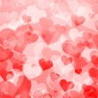 Red background with hearts — Stock Photo #10060214