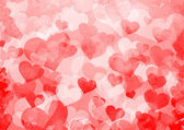 Red background with hearts — Stock Photo