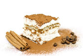 Homemade Tiramisu cake with cinnamon and coffee beans — Stock Photo