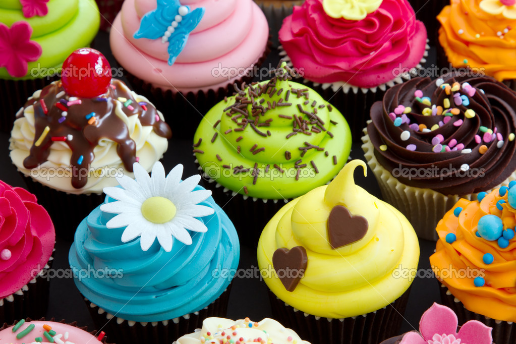 Assortment of brightly decorated cupcakes — Stock Photo #10657441