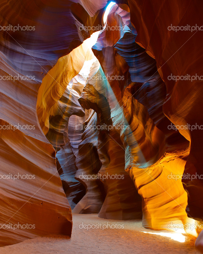 Colorful image of a sun light beam shining through the Upper Antelope slot Canyon.  Stock Photo #10328476