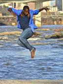 African American dancer on the James River Richmond. — Stock Photo