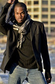 African American male model at the river — Stock Photo
