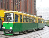 Green tram on street of Stockholm, Sweden — Stock Photo