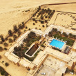 Luxury hotel with a swimming pool in Sahara, Tunisia - Stock Photo
