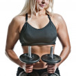 Fitness blonde with dumbbells - Stock Photo