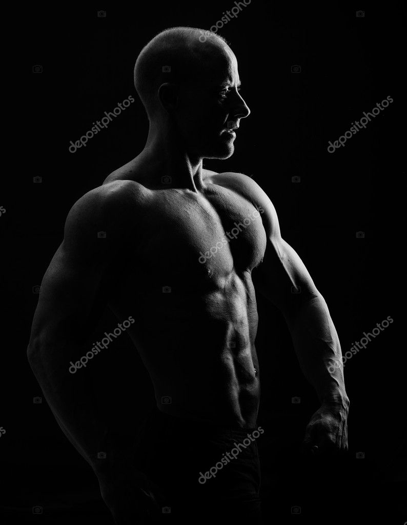 A very fit young male flexing his muscles — Stock Photo #10614876