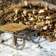Sled and firewood — Stock Photo