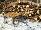 Sled and firewood — Stockfoto