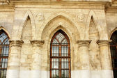 Wall of the white stone gothic church — Stock Photo
