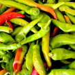 Green chili pepper laid out for sale — Stock Photo