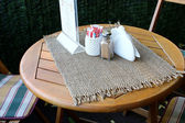 Table in the outdoor summer cafe — Stock Photo
