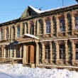 Stock Photo: Facade of old wooden building in winter