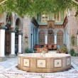 Eastern courtyard with a fountain - Stock Photo